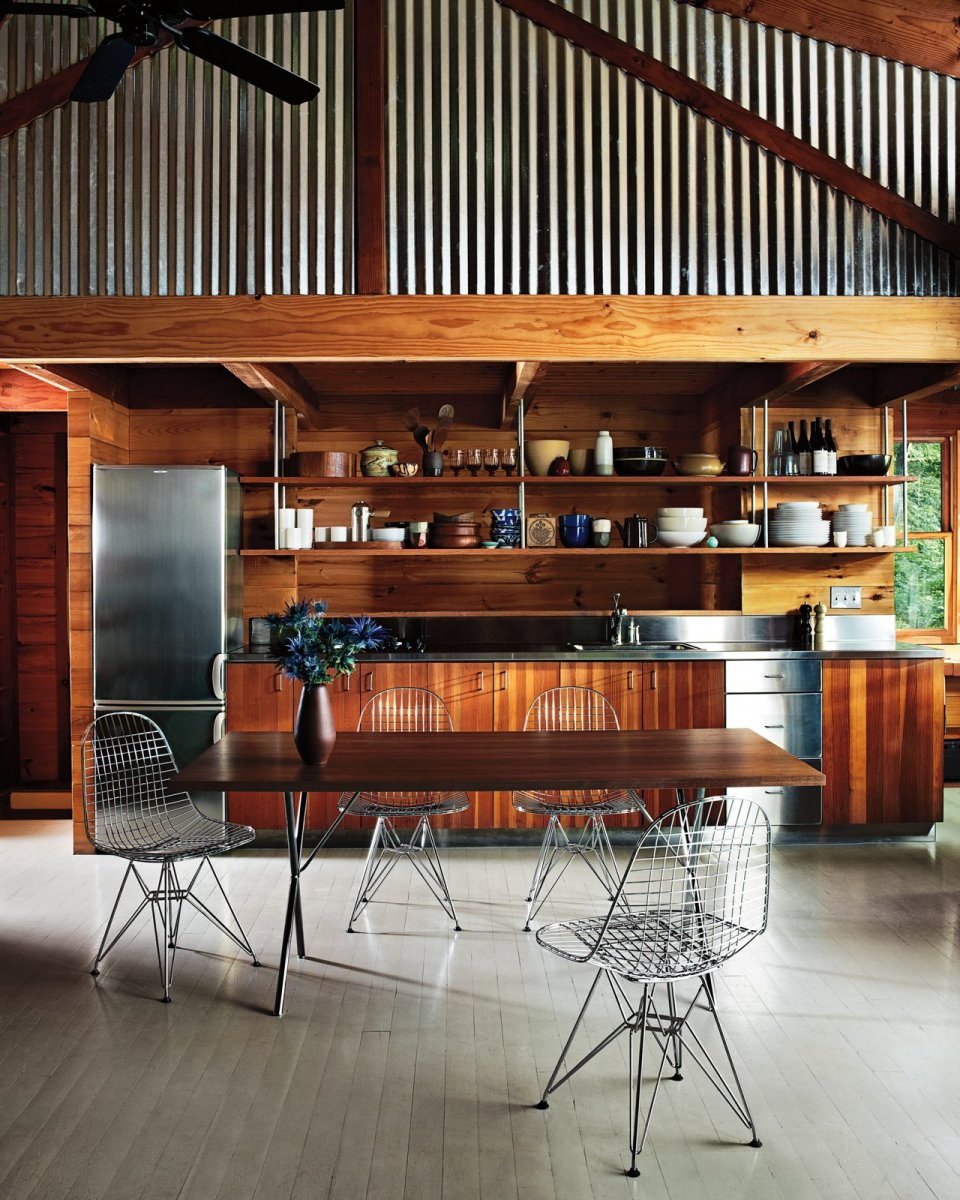 Loft kitchen with Eames Wire Chairs and Nelson X-Leg Table.