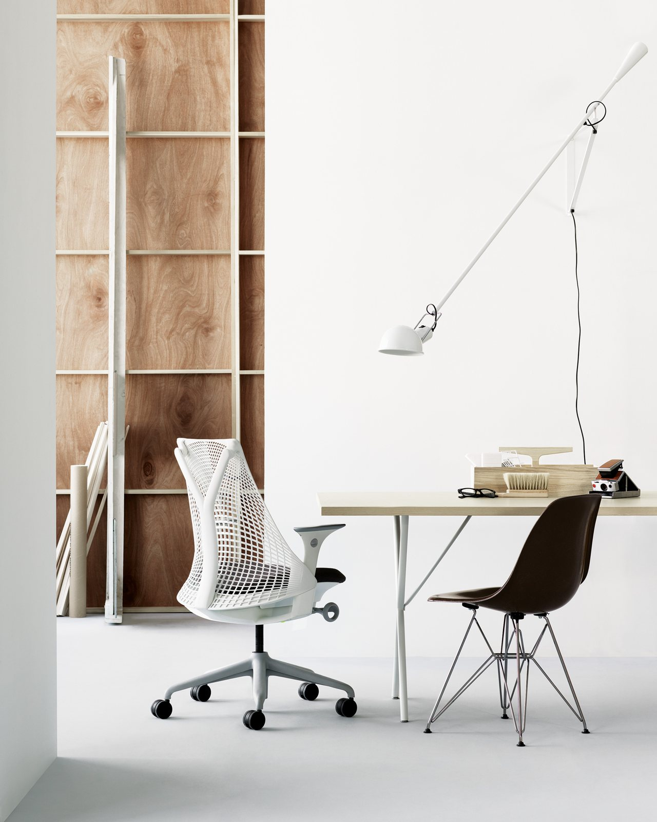 Workspace with Nelson X-Leg Table, Eames Molded Fiberglass Chair and Sayl Chair.