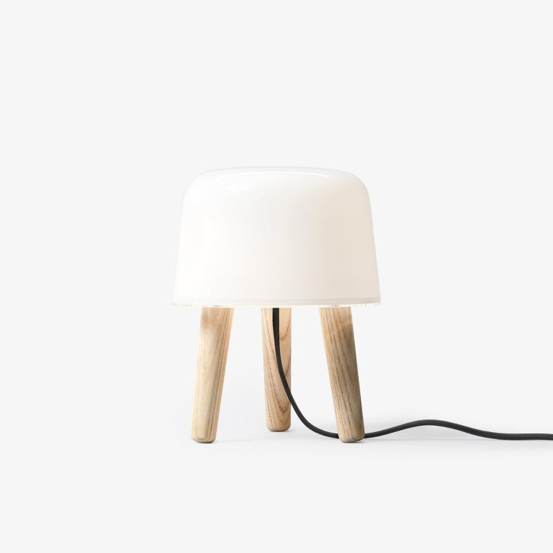 Milk Table Lamp NA1, untreated ash legs with black fabric cord.