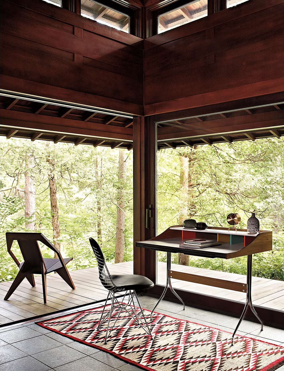 nelson swag leg desk by george nelson for herman miller  up interiors - nelson swag leg desk adjustable glides attic workspace with a panoramicwoods view © francois dischinger