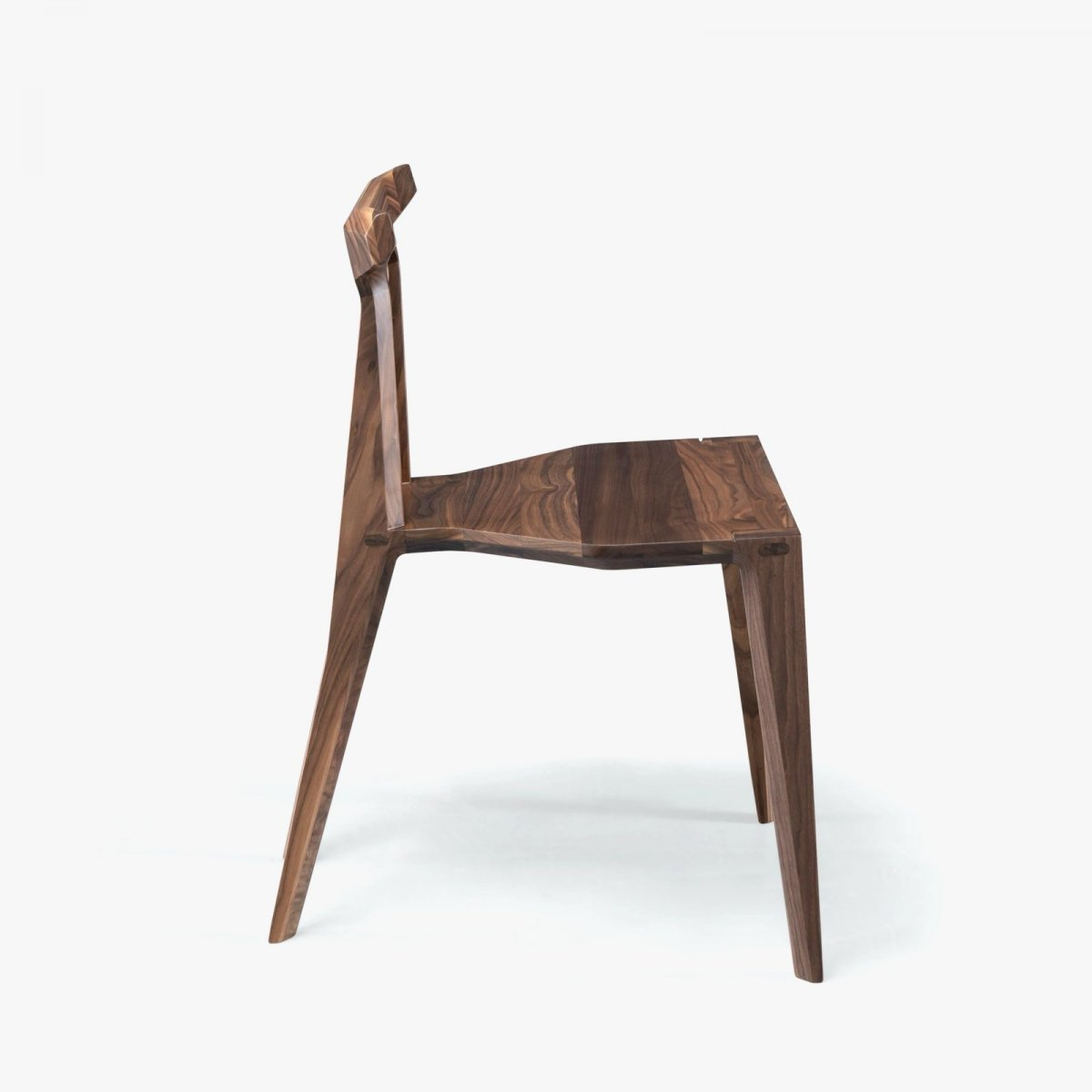 Orca Chair, walnut, side view.