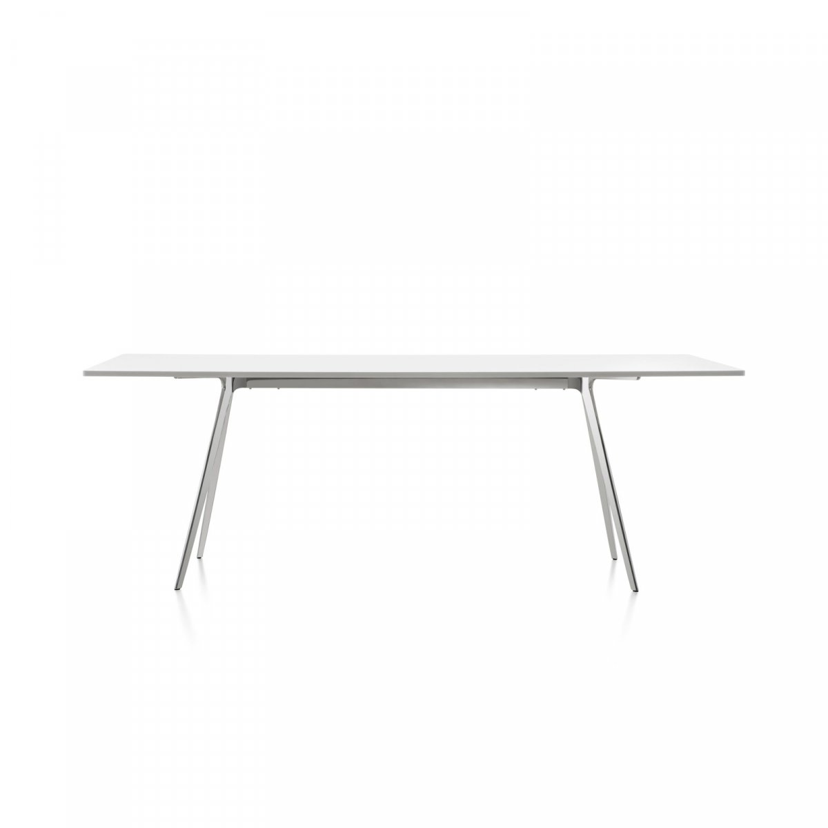 Baguette dining table, with white top and polished legs.