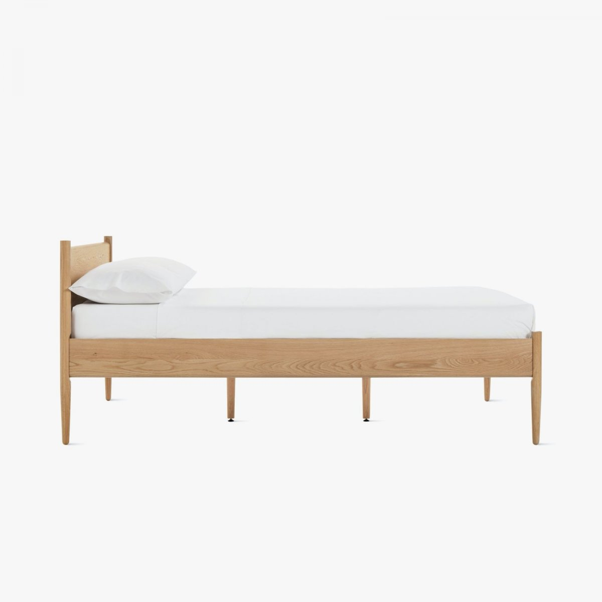 Cove Bed, oak, side view.
