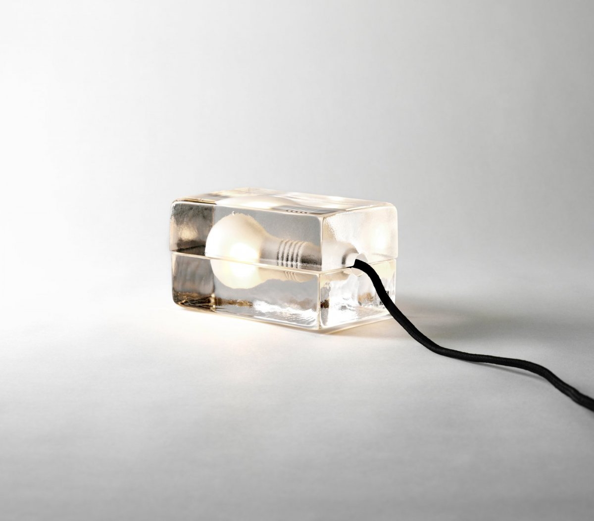 Block Lamp, black cord, lit.