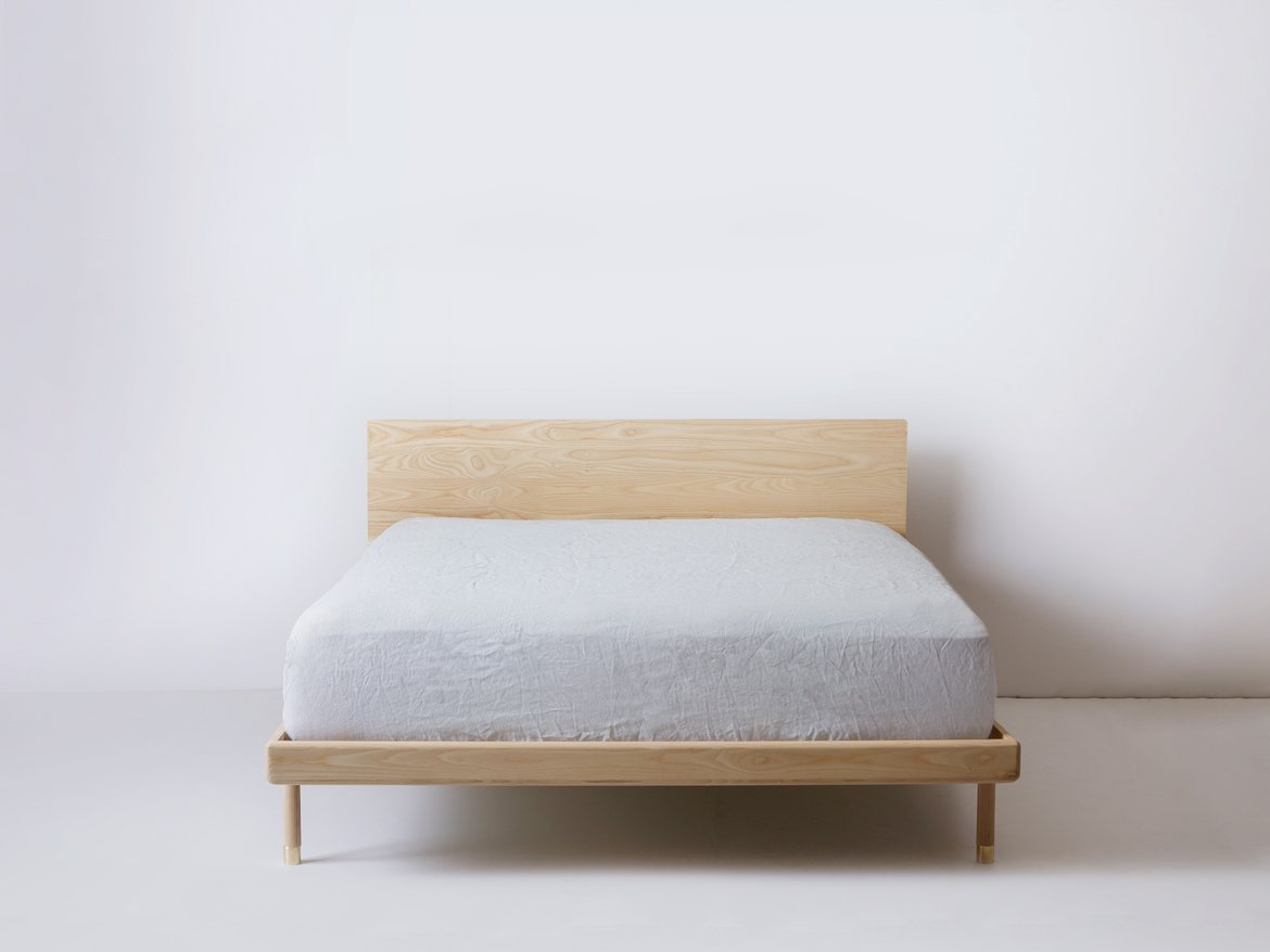 Simple Bed ash with headboard.
