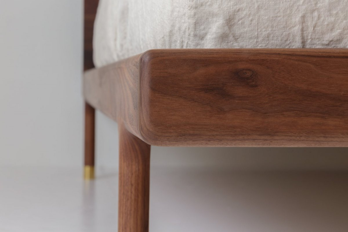 Simple Bed walnut detail.