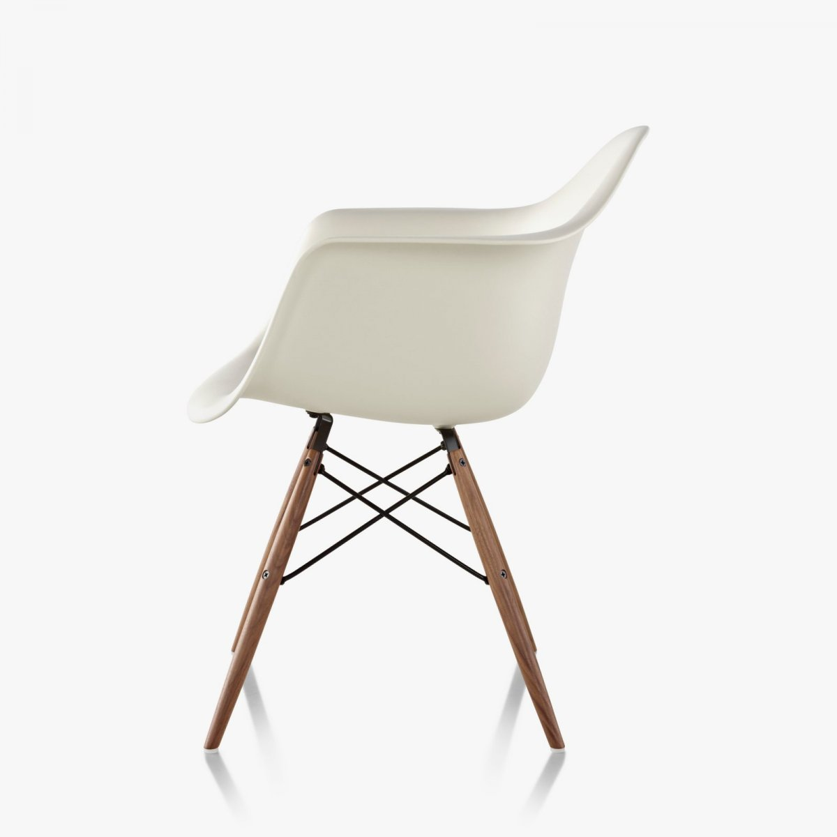 Eames Molded Plastic Armchair Dowel Base, white, side view.