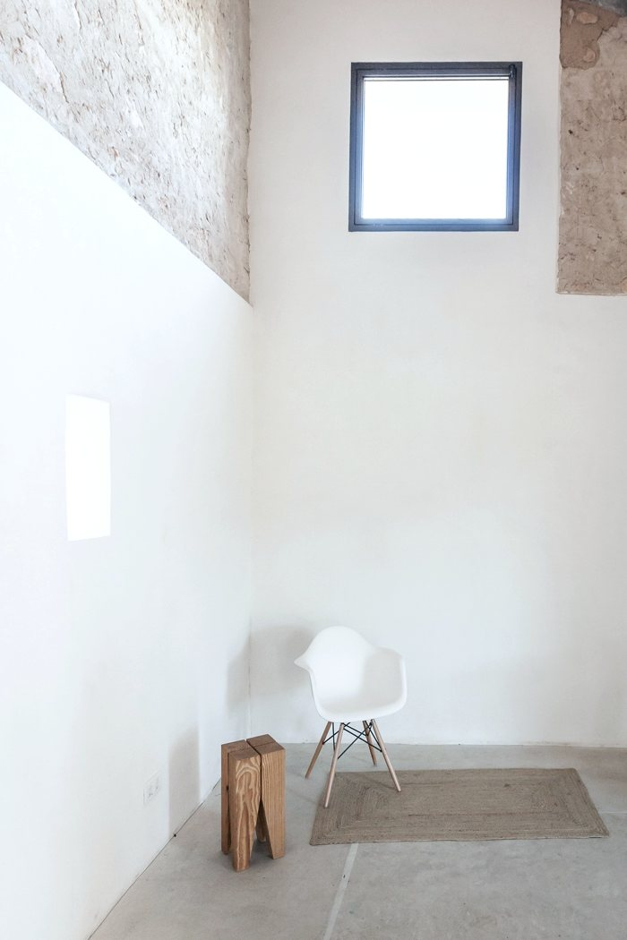 High ceiling rustic space. Can Valls by Munarq Studio