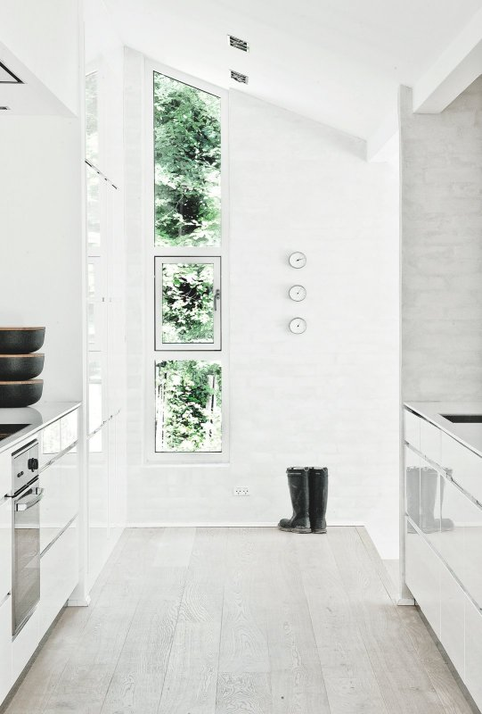 Vertical angled window. Fredensborg House by Norm Architects