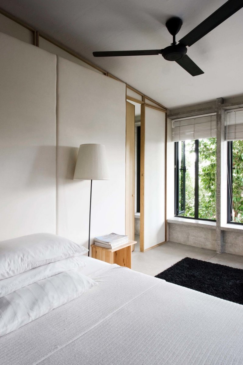 Asian bedroom combining rustic and modern. Home of Wen Hsia and BC Ang