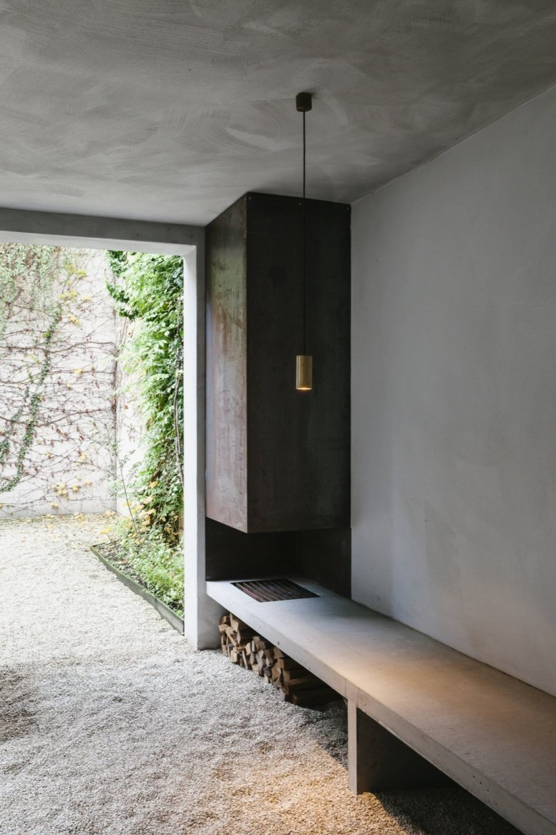 Outdoor wood-burning fireplace. Renovation House V Antwerp by Hans Verstuyft Architecten