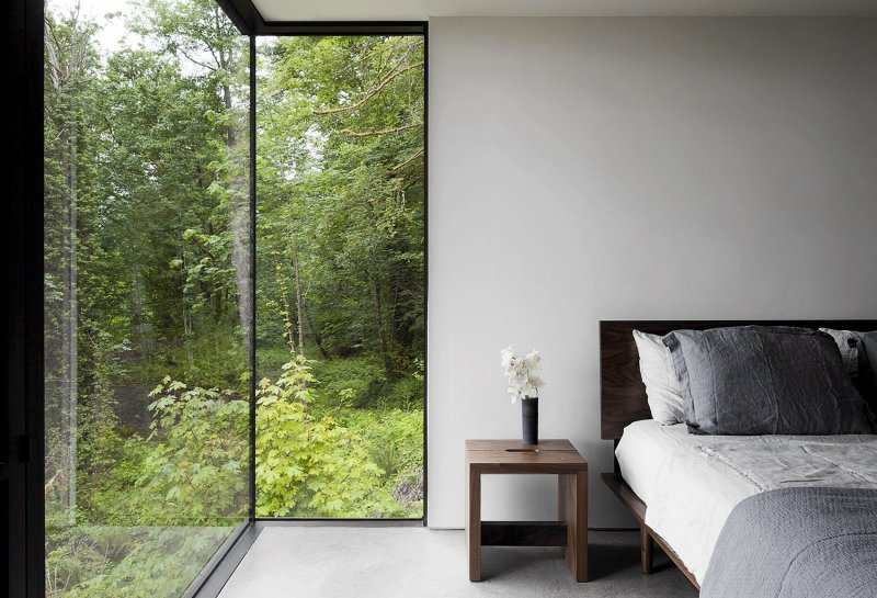 Bedroom with floor-to-ceiling windows. Case Inlet Retreat by Mw|works