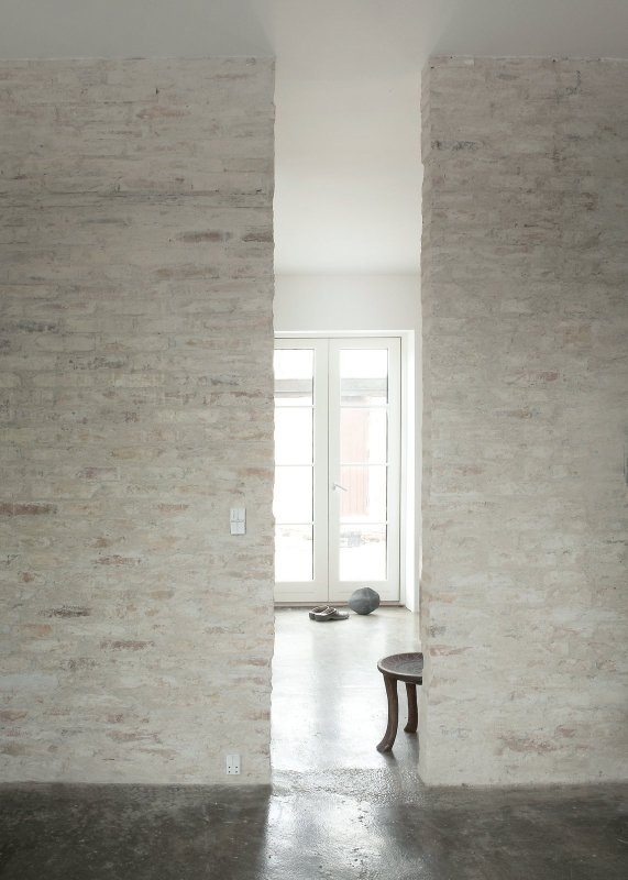 Cut-out in rustic brick wall. Humlebaek House by Norm.Architects