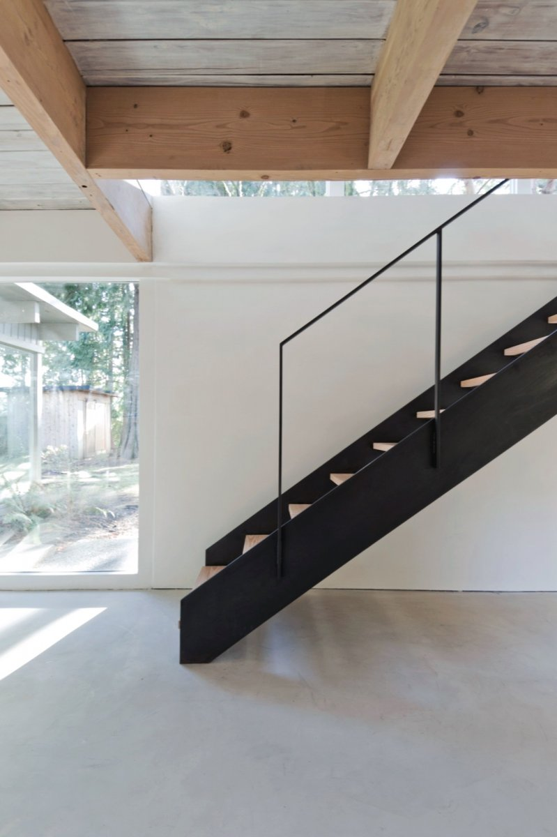 Black steel staircase. North Vancouver House by Scott & Scott Architects