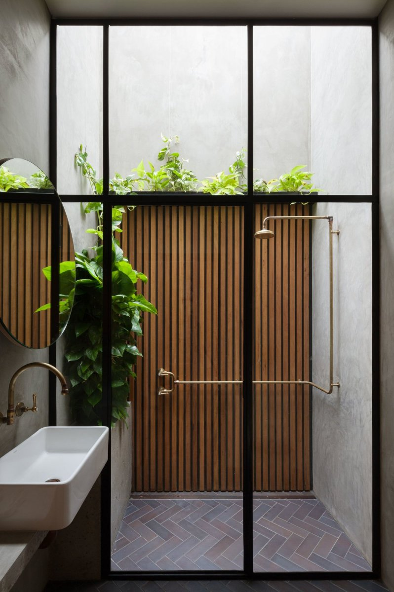 Shower under light well. Double Life House by Breathe Architecture