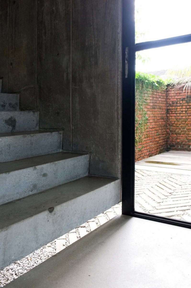Floating concrete staircase. Home of Wen Hsia and BC Ang