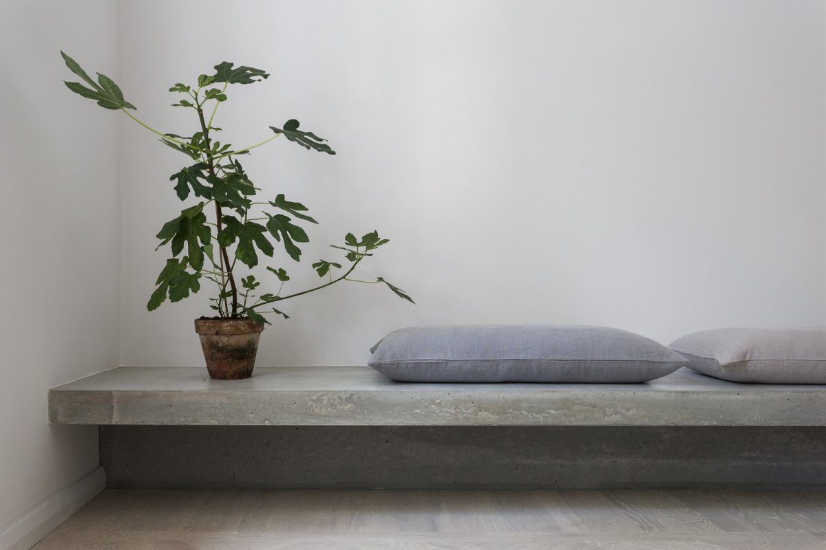 Concrete bench. Gold & Gray Apartment by Richard Lindvall