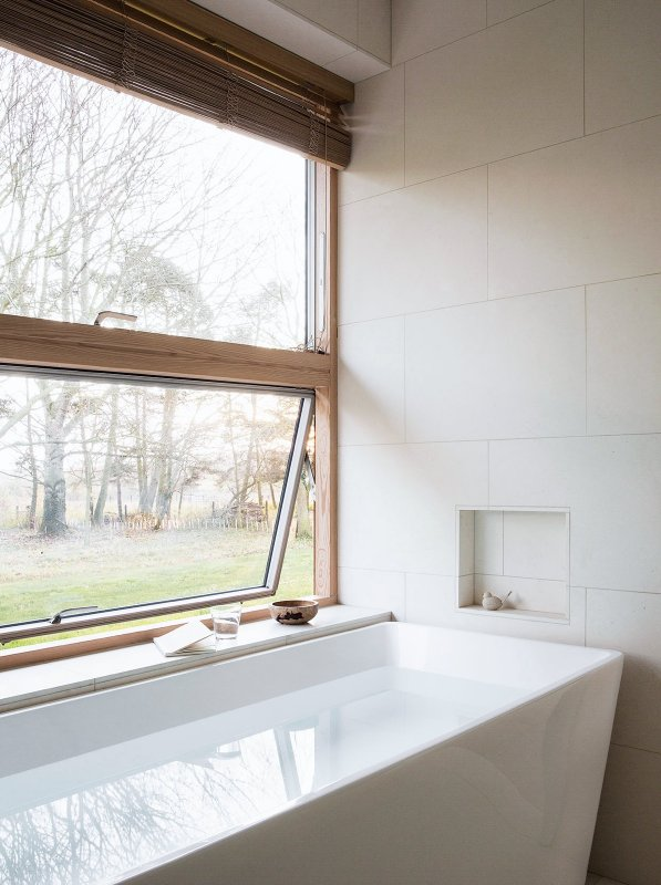 Bathtub by window. Reydon Grove Farm by Norm Architects