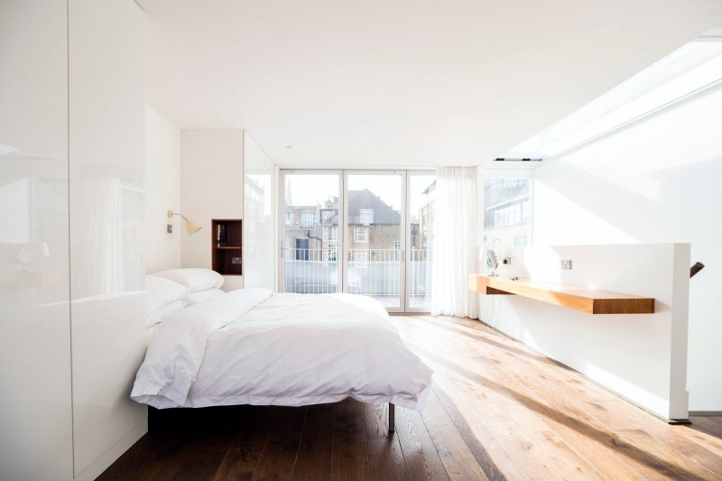 Sunny loft bedroom. Home of artist Michael Landy by Marta Nowicka & Co