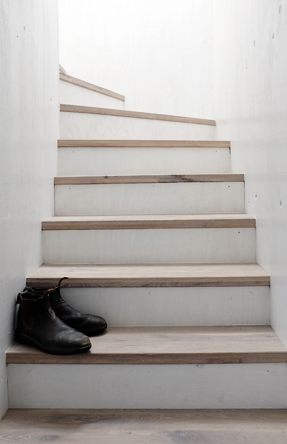 Stairs with wooden treads. Strandwood House by Kilian Piltz and Wolgang Warnkross