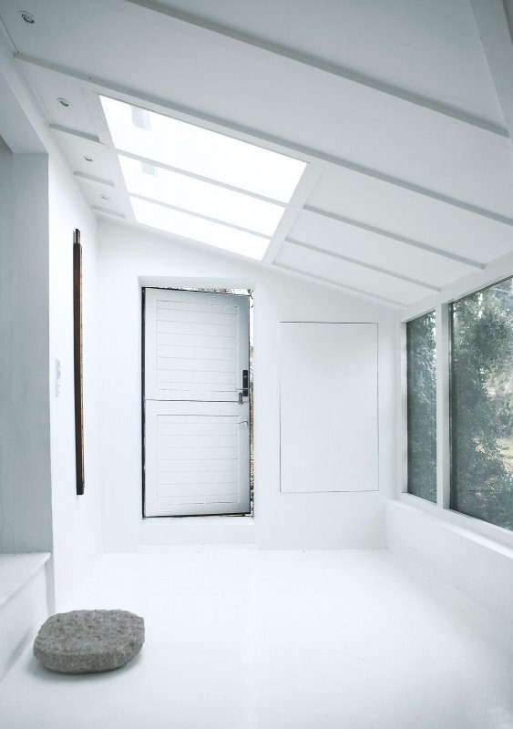 White mudroom. Vedbæk House I by Norm.Architects