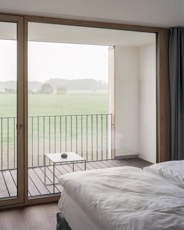 Floor-to-ceiling wood-framed window. Pleiskirchen by Almannai Fischer