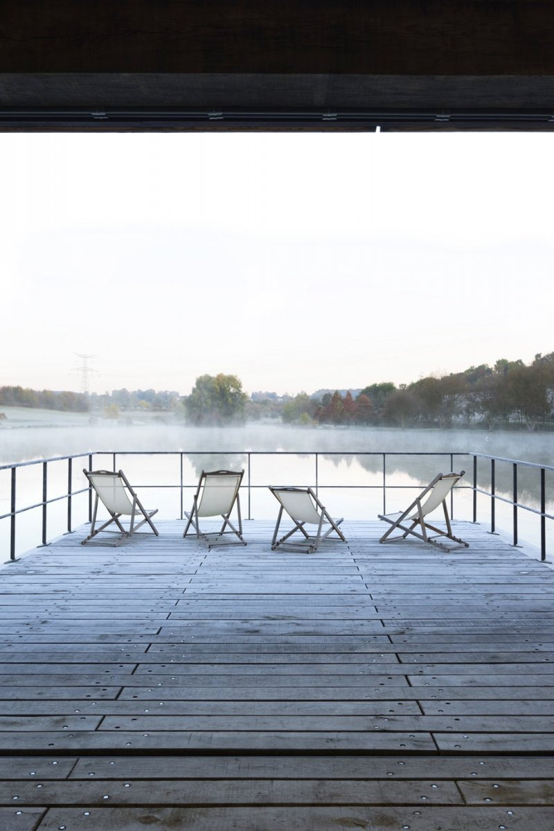 Wooden deck on lake. Conference room at Moulin de la Forge by Bernard Desmoulin
