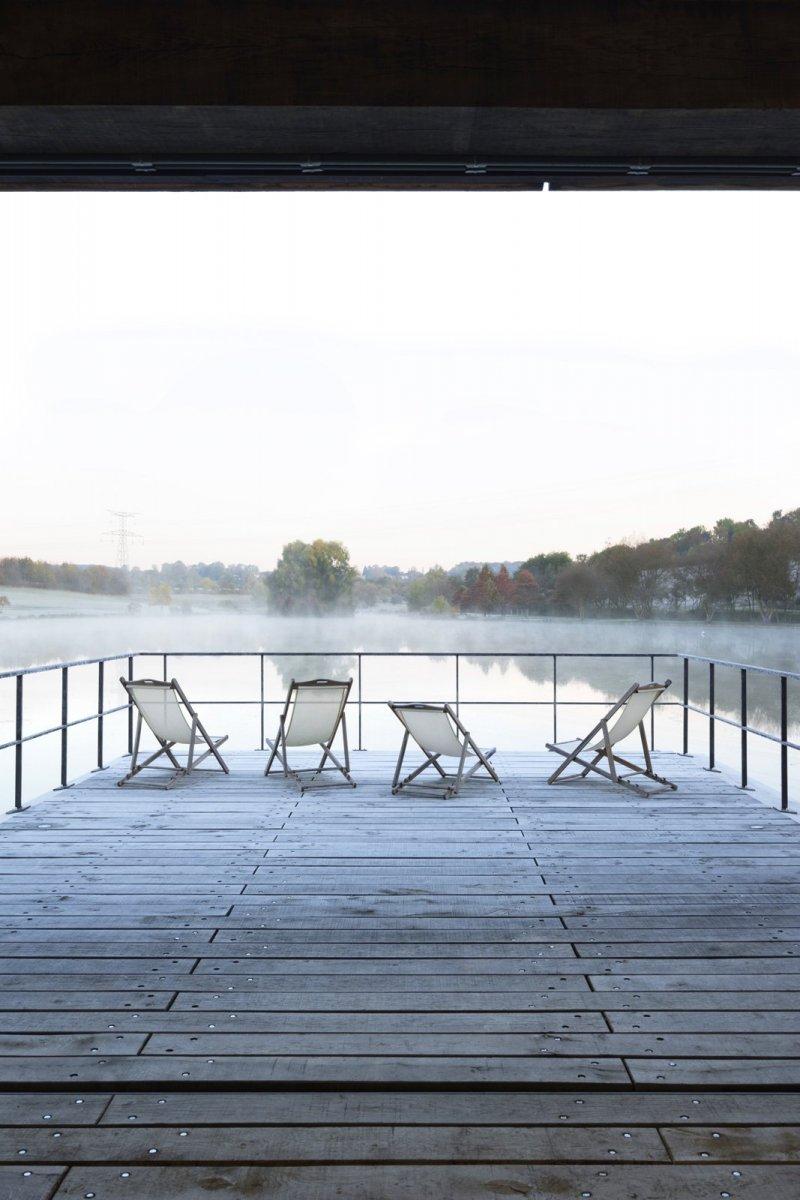 Wooden deck on lake. Conference room at Moulin de la Forge by Bernard Desmoulin