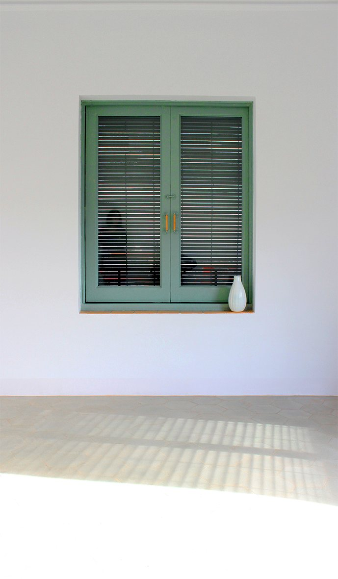 Window with wood blinds. Acàcies by LoCa Studio