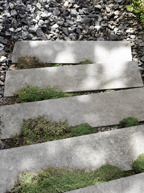 Stepping stones with moss. Attefall house of Pella Hedeby