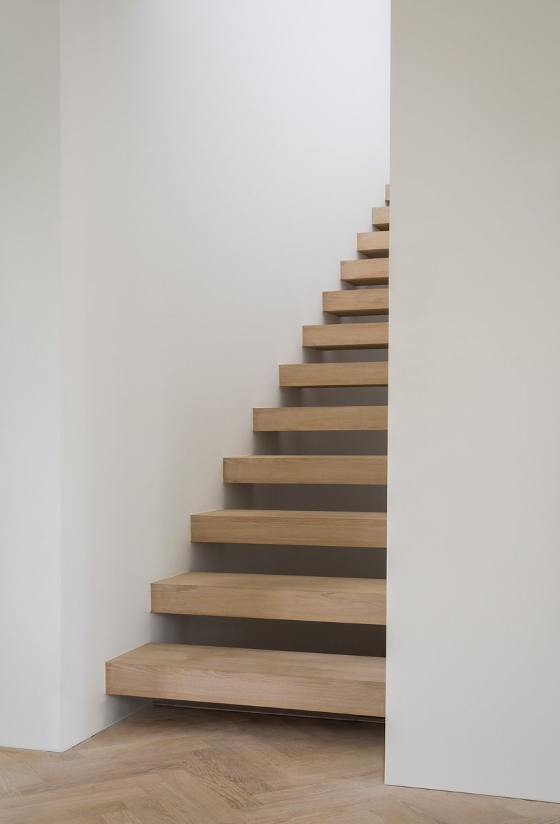 Open riser oak stairs. PH House by Norm Architects