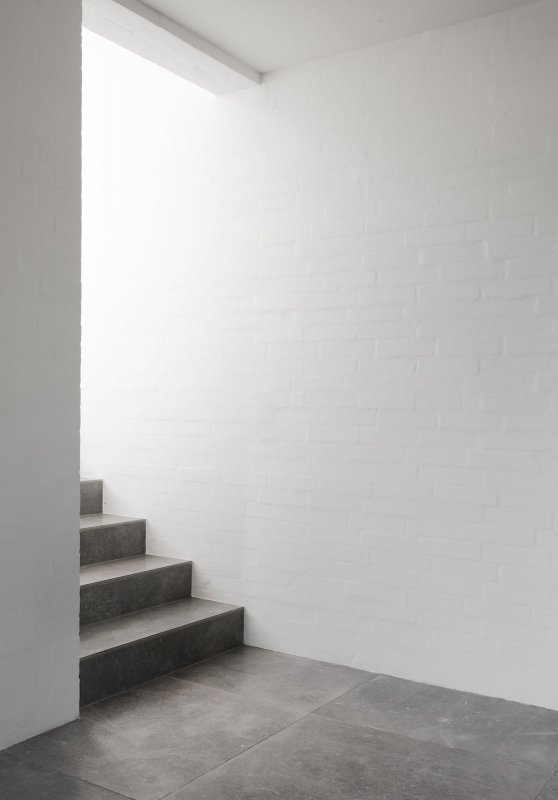 Marble stairs and brick wall. Modernist Residence by Norm Architects