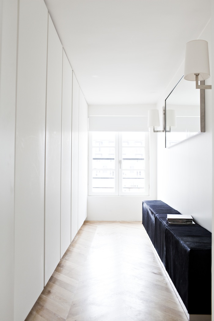 Transitional dressing area. Appartement Poissonniere by Frederic Berthier Architecture