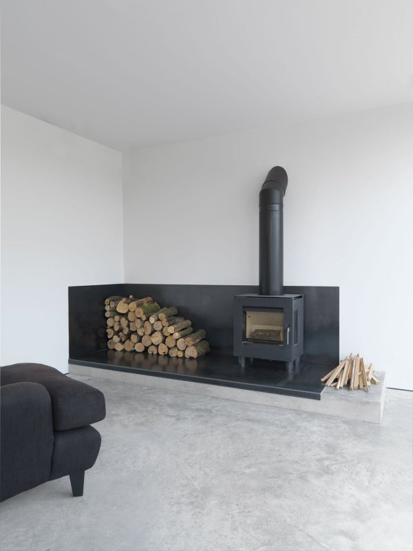 Industrial fire space with stove. Feversham House by McLaren Excell
