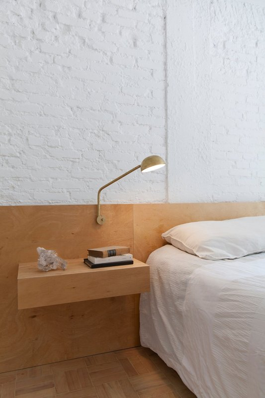Plywood headboard and floating nightstand. Ap Cobogó by Alan Chu