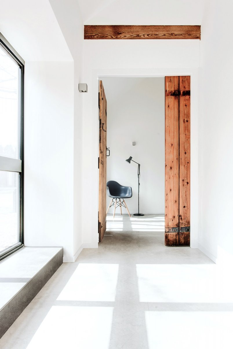 Hallway with old wooden door. The Stables by AR Design Studio