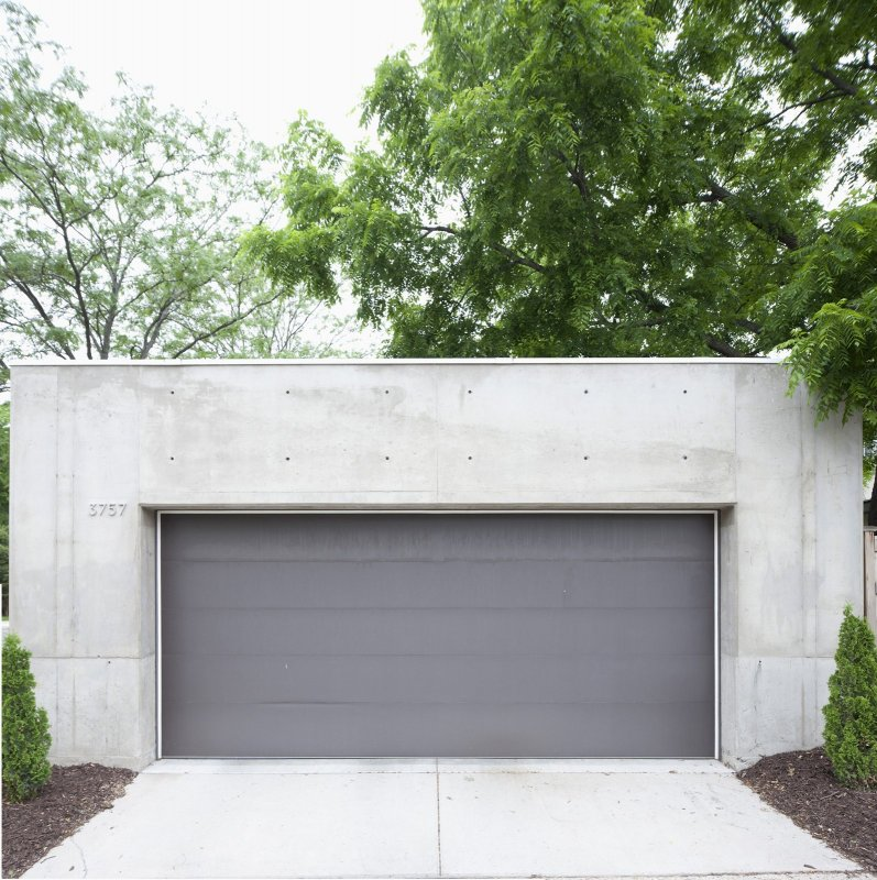 Concrete garage. B + W House by Snow Kreilich Architects