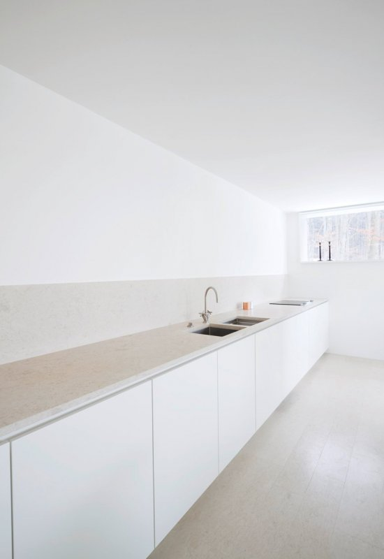 Long kitchen counter. House O by Philipp Mainzer