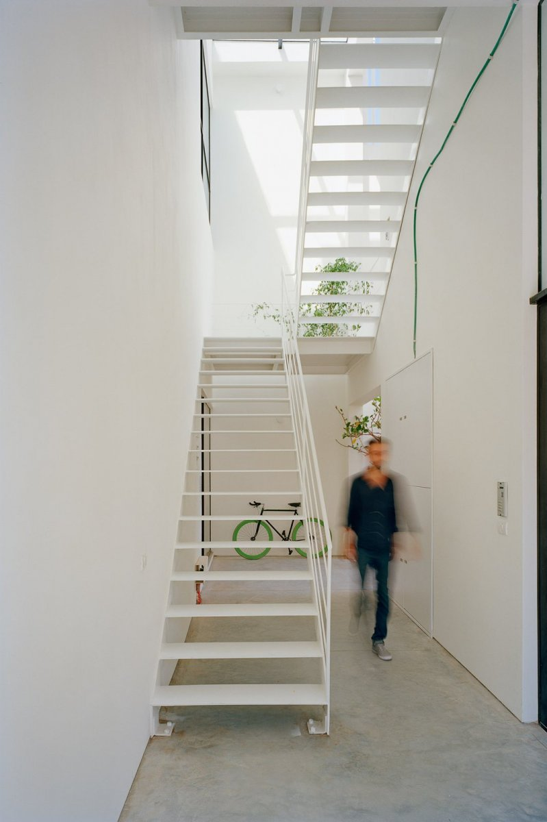 White metal staircase. Apartment building by AN+